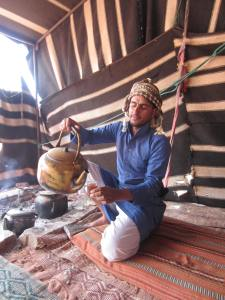 Awad, our Bedouin guide preparing us tea