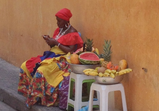 Afro-Caribbean woman selling exotic fruits