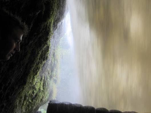 Simon's face, behind the falls