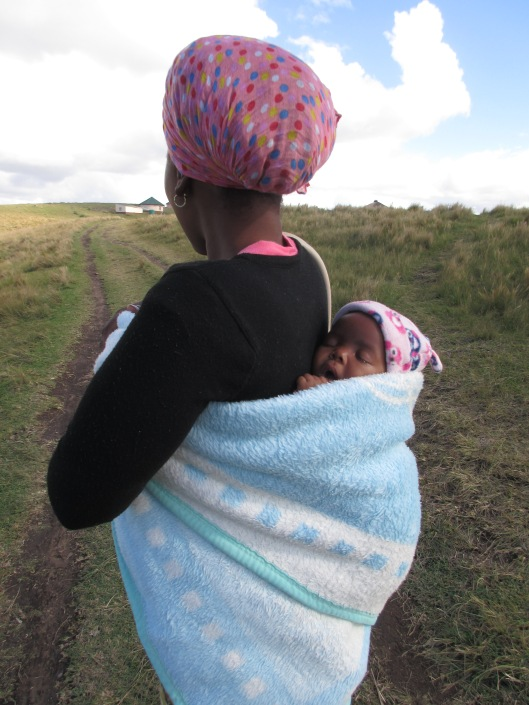Local Xhosa woman carrying her baby